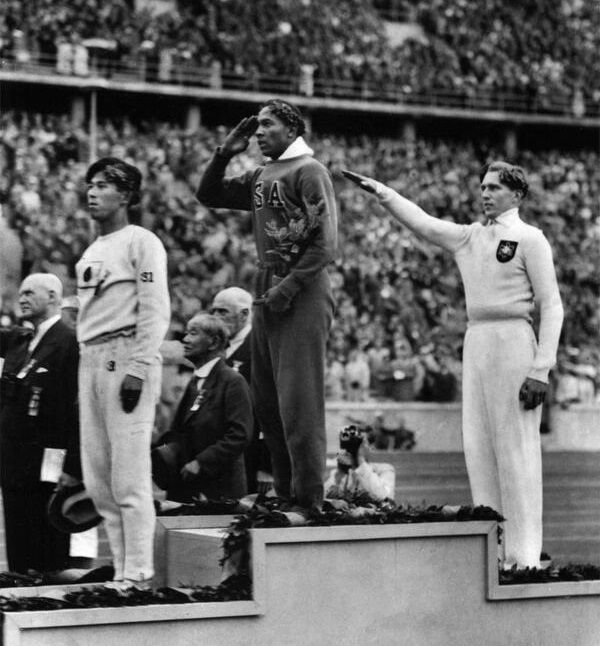 Jesse                                                          Owens wins                                                          gold in Nazi                                                          Germany 1936